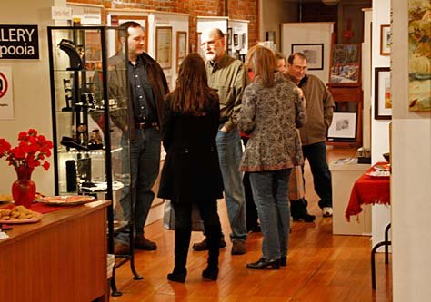 Visitors to Gallery Calapooia's Valentine Reception
